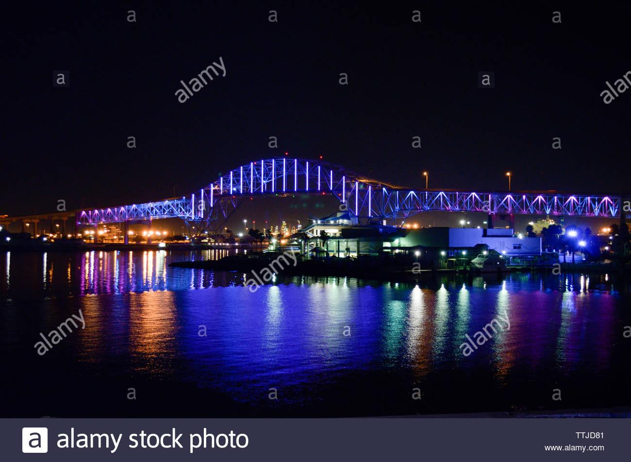 Bridge at night. Bridge lit up at night. Corpus Christi Harbor Bridge at Night. LED lighting. LED lighting on bridge. Colorful LED Lighting. Colourful - Stock Image