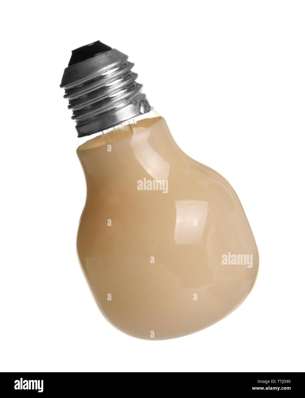 Decorative beige light bulb, isolated on white - Stock Image