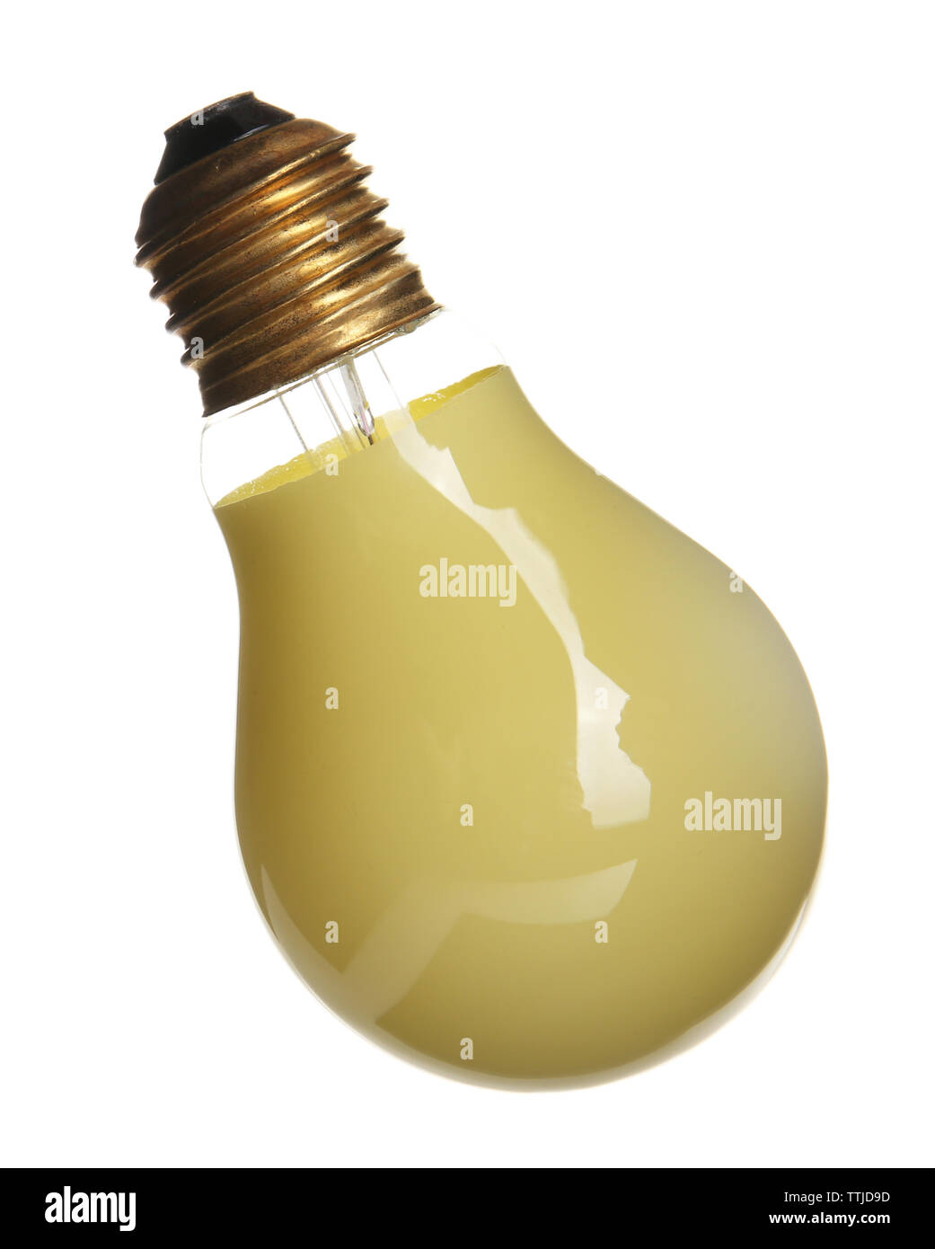 Decorative yellow light bulb, isolated on white - Stock Image