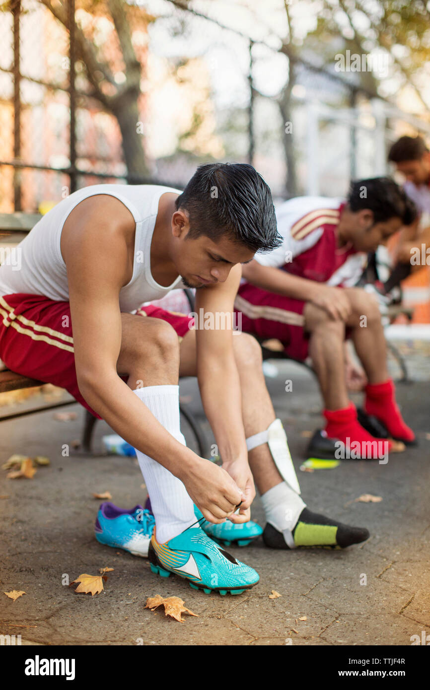 Soccer players wearing shoes at field - Stock Image