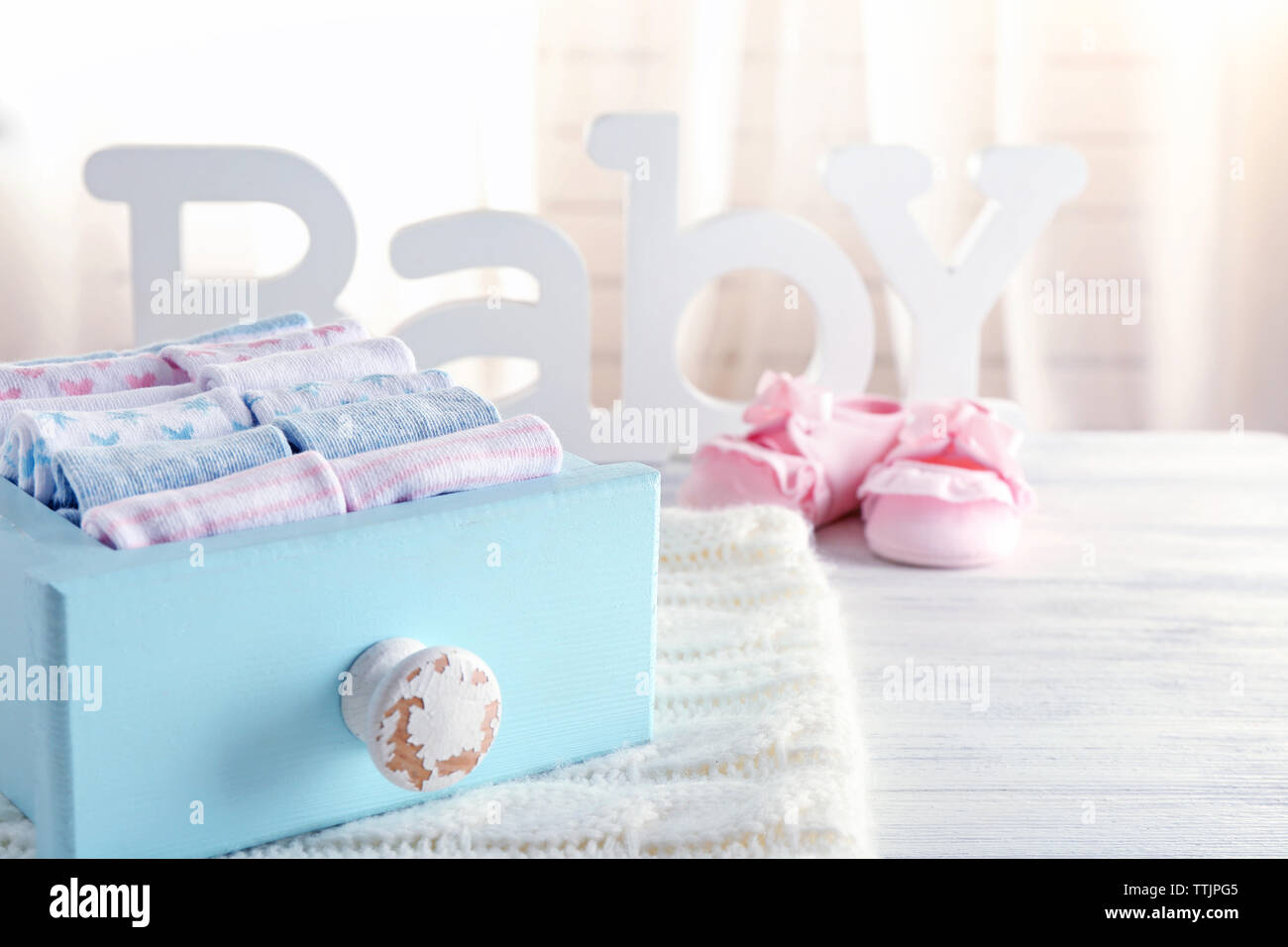 Clean baby linen on knitted plaid - Stock Image