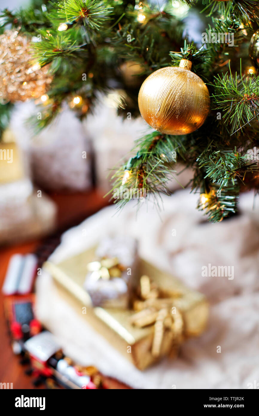Close-up of golden bauble on Christmas tree Stock Photo