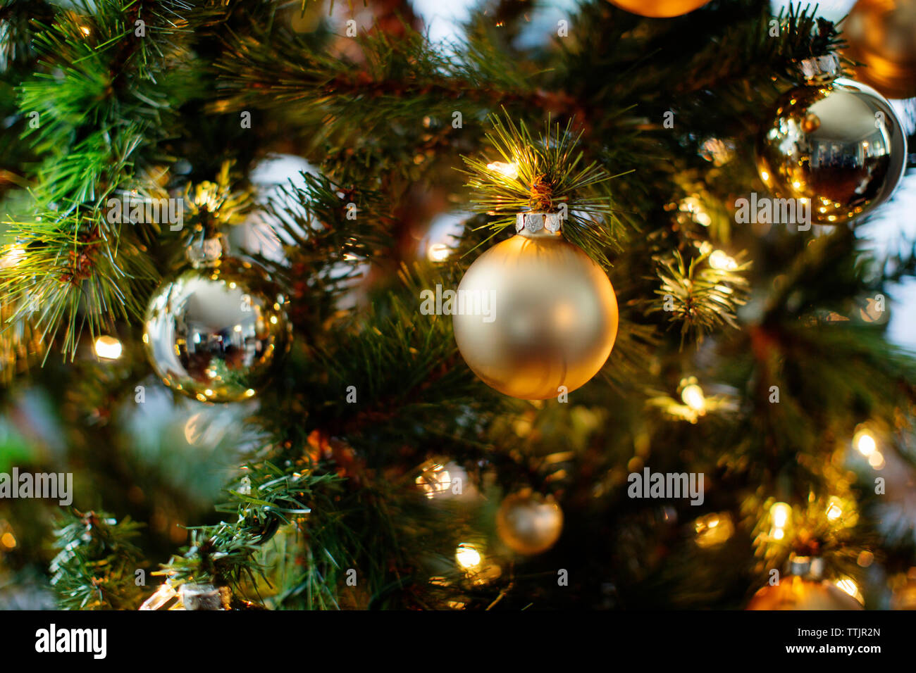 Close-up of ornaments and lights on Christmas tree Stock Photo