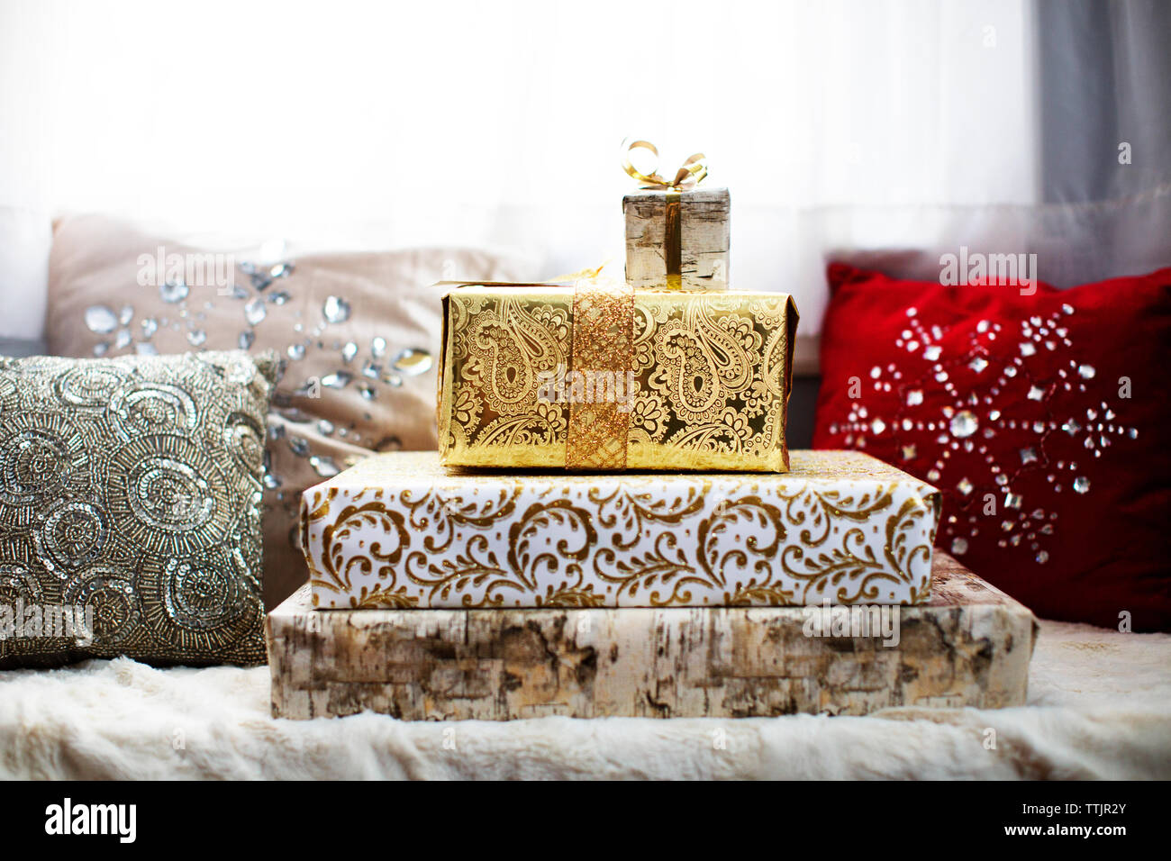 Gift boxes and cushions on alcove window seat Stock Photo