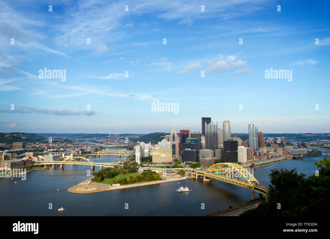 High angle view of bridges over river in Pittsburgh city against blue sky - Stock Image