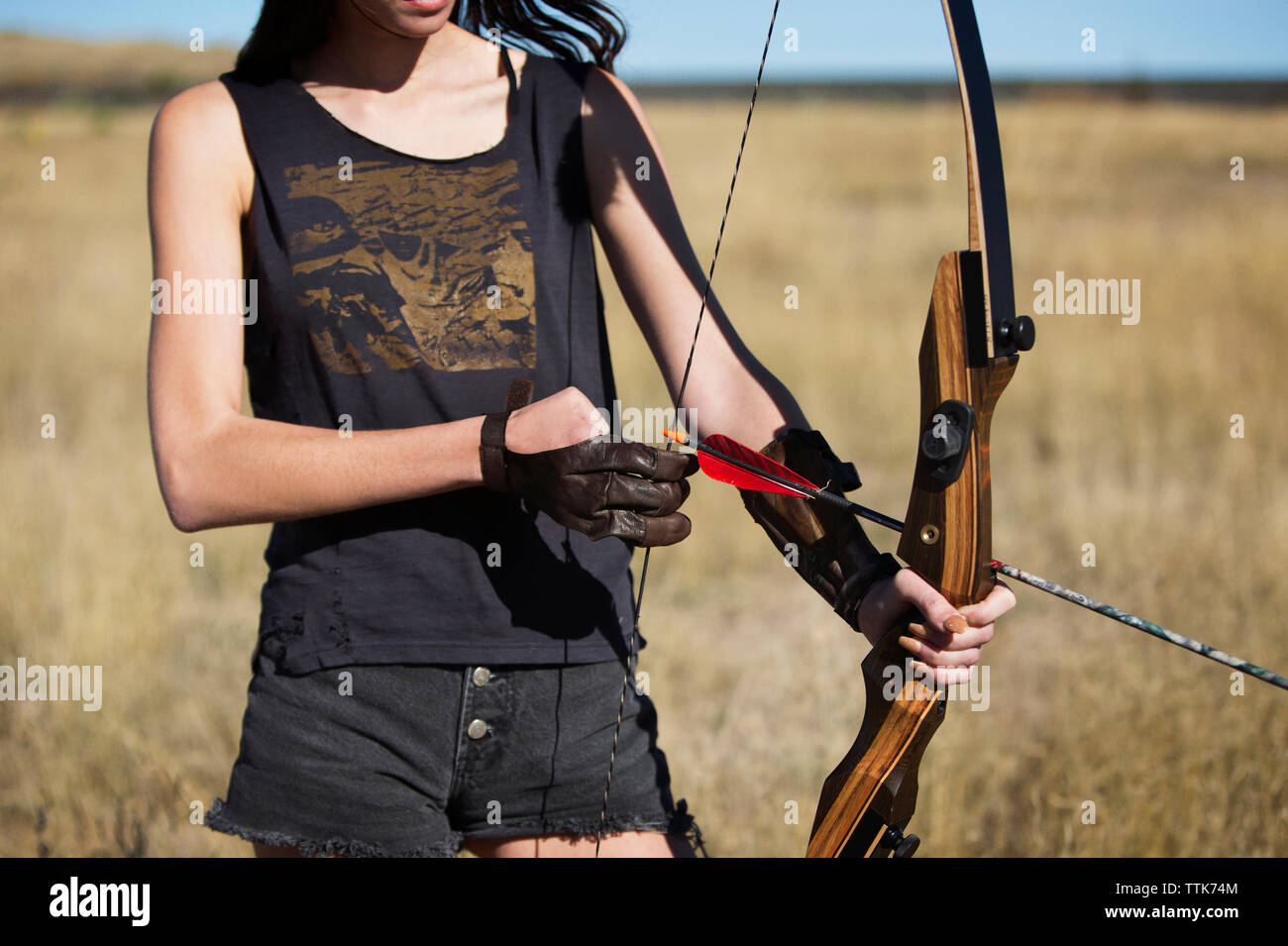 080a27d66ffb Woman Hunting Bow And Arrow Stock Photos & Woman Hunting Bow And ...