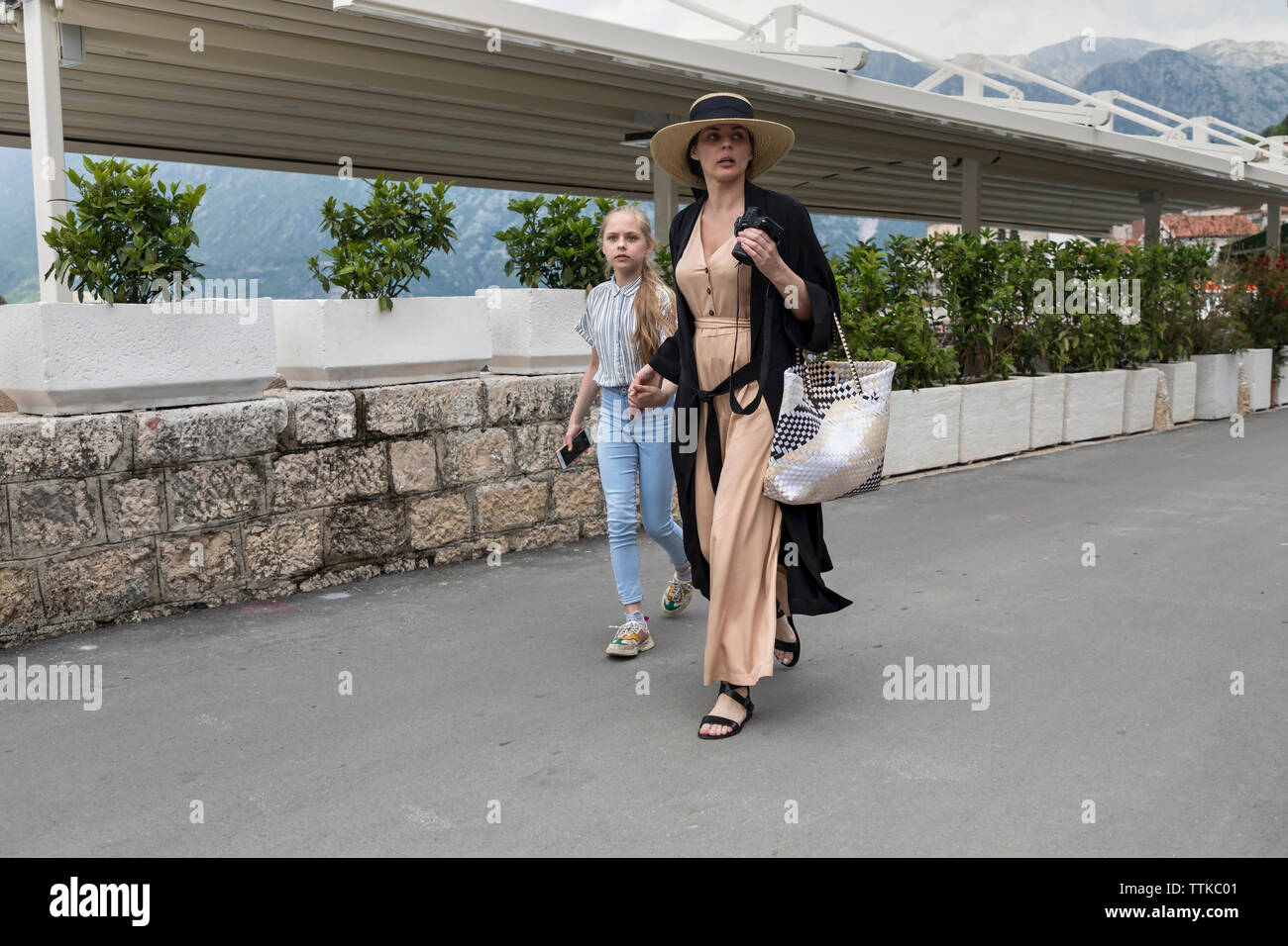 Perast, Montenegro, May 3rd 2019: Mother and daughter on vacation walking down the street - Stock Image