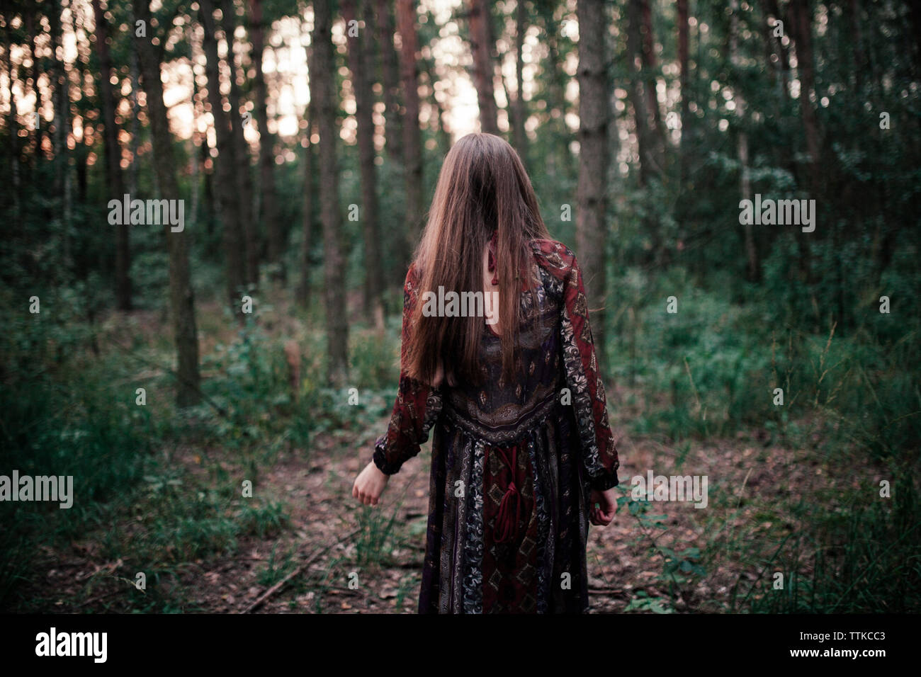 woman walking in the woods Stock Photo