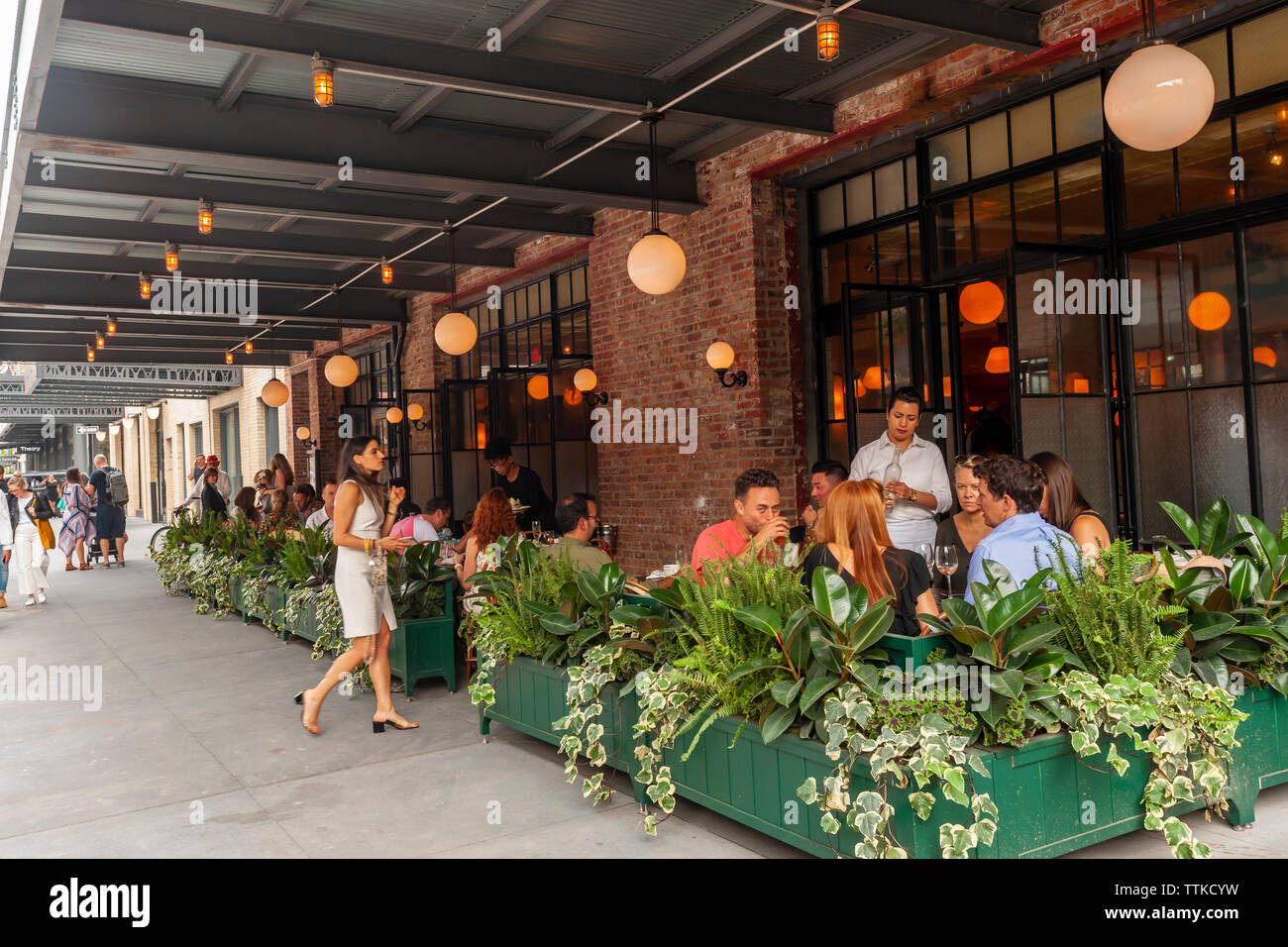 Diners in the new Pastis restaurant in the Meatpacking District in New York on Friday, June 7, 2019 on its opening. Opened in 1999 and closed in 2014 the original has taken on a legendary status, attracting celebrity and regular patrons. (© Richard B. Levine) Stock Photo