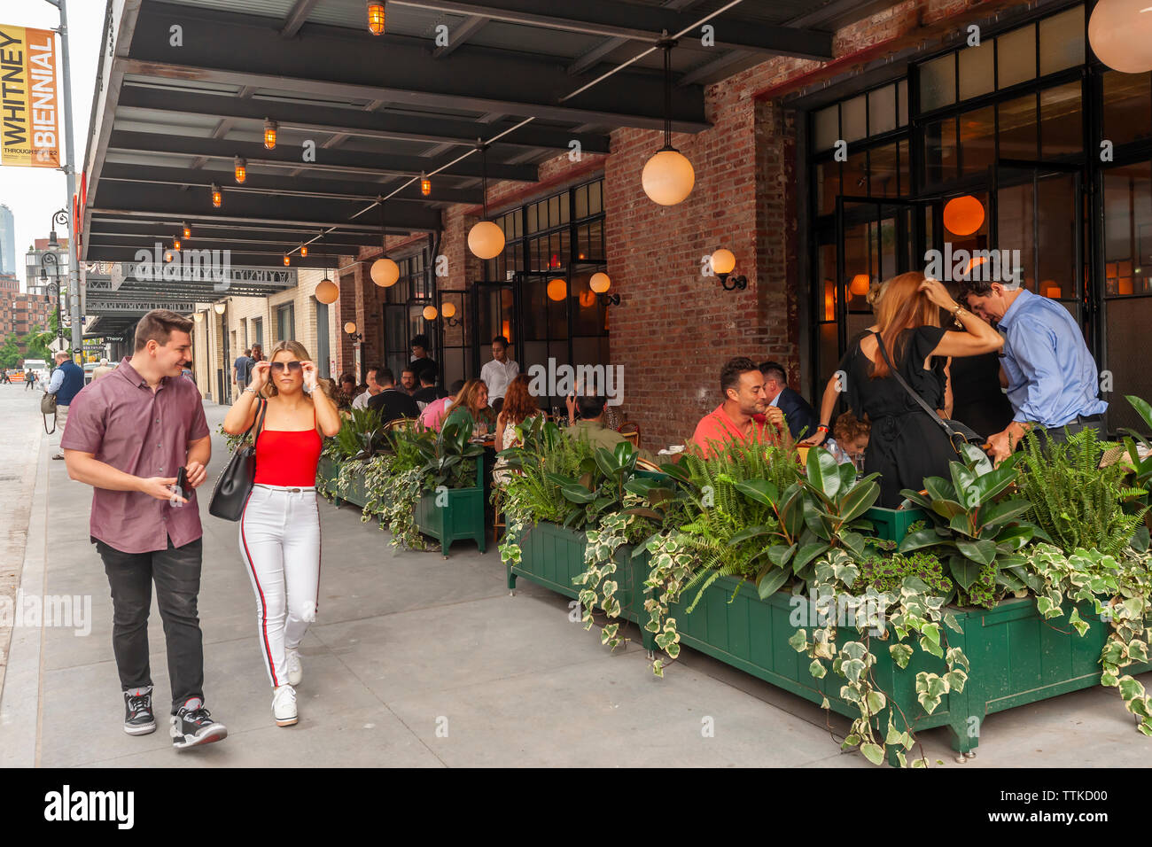 Diners in the new Pastis restaurant in the Meatpacking District in New York on Friday, June 7, 2019 on its opening. Opened in 1999 and closed in 2014 the original has taken on a legendary status, attracting celebrity and regular patrons. (© Richard B. Levine) - Stock Image
