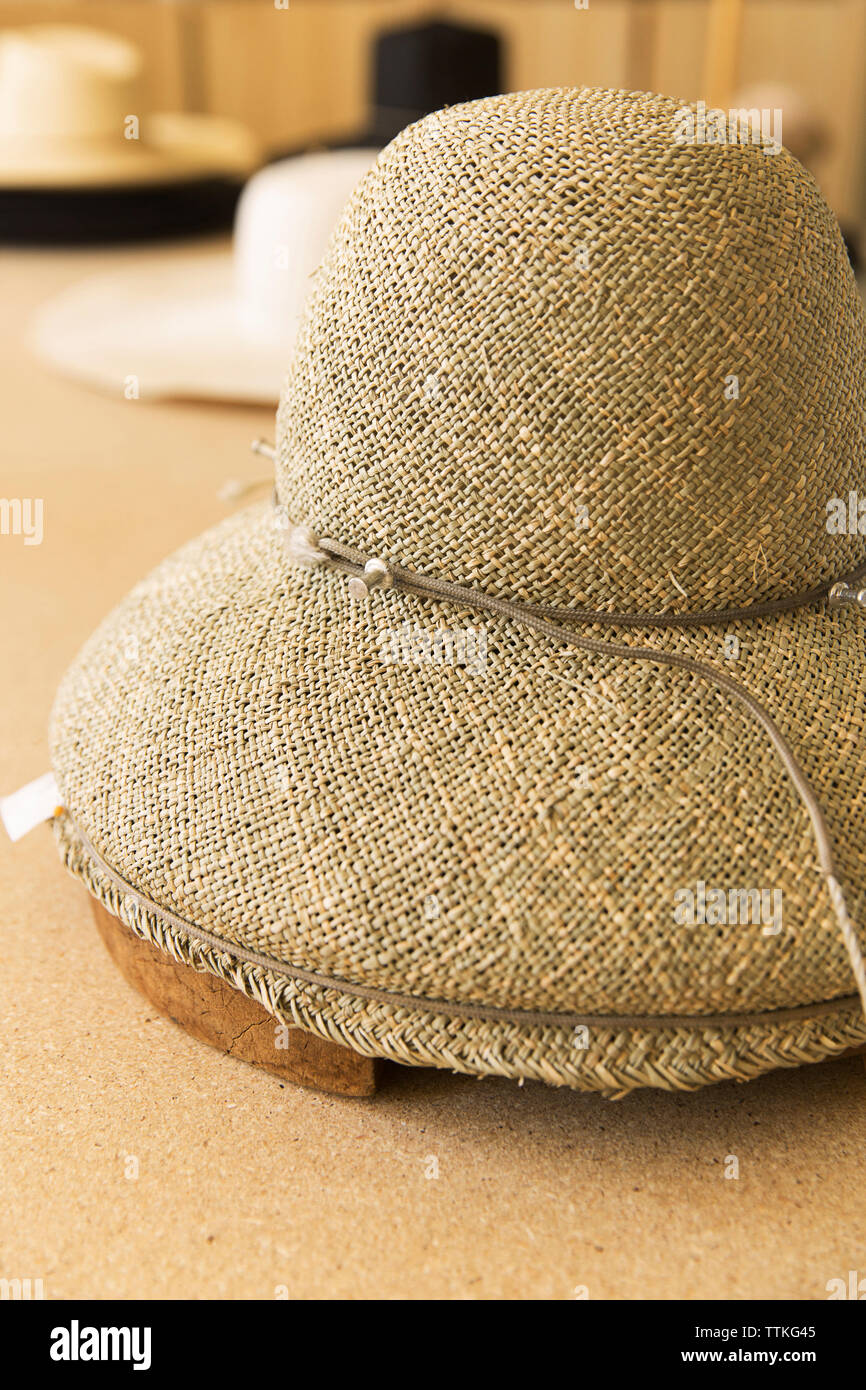 High angle view of straw hat on table - Stock Image