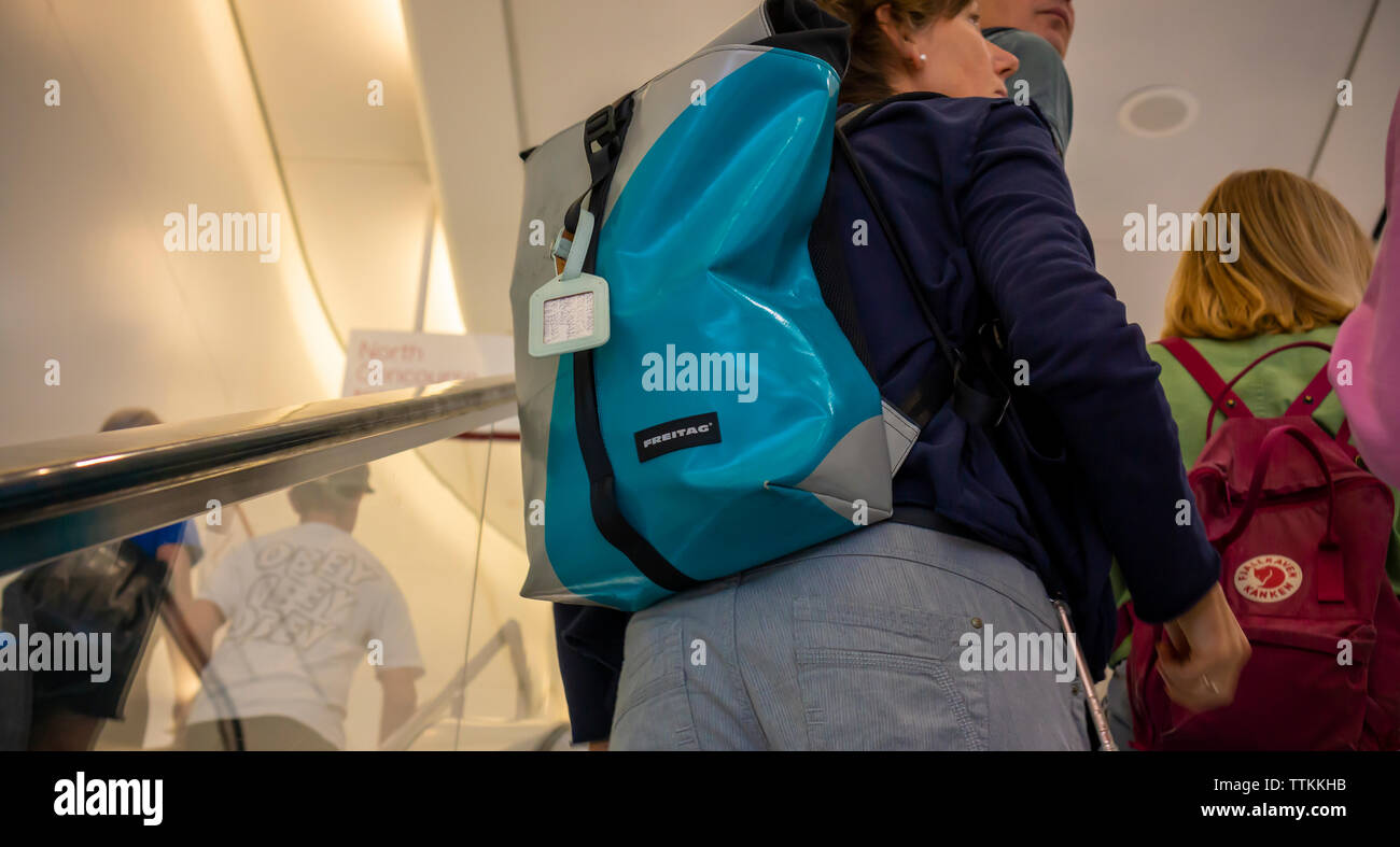A Freitag backpack on a tourist in New York on Saturday, June 15, 2019. The bags are an example of an 'upcycled' product  as they are made from used truck tarps. (© Richard B. Levine) - Stock Image