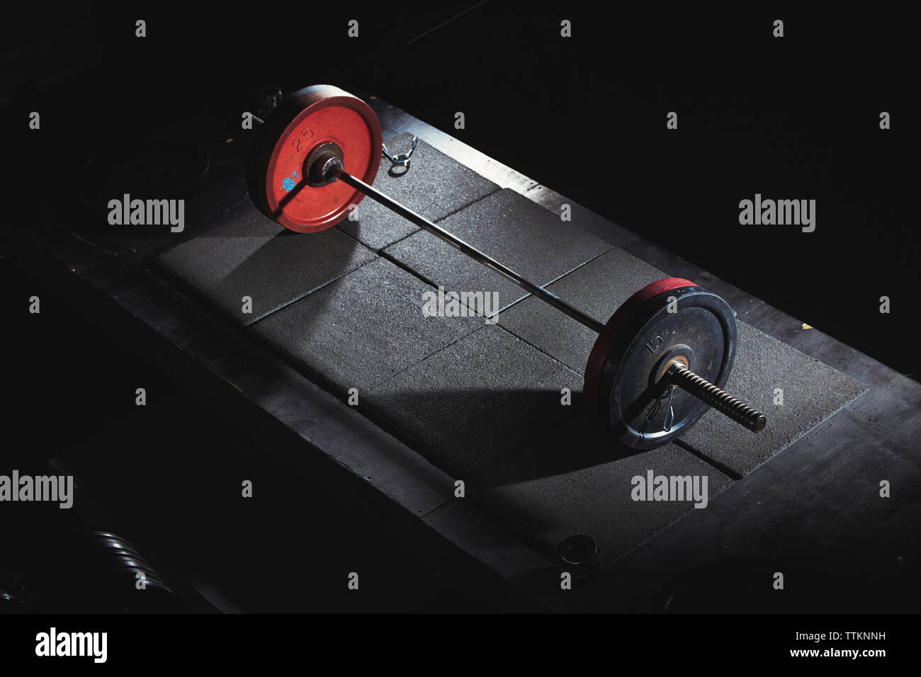 Close-up of barbell in gym - Stock Image