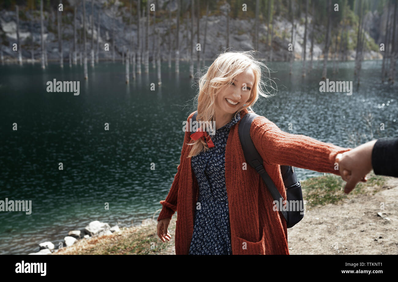 Couple having fun at Kaindy Lake, Kazakhstan - Stock Image
