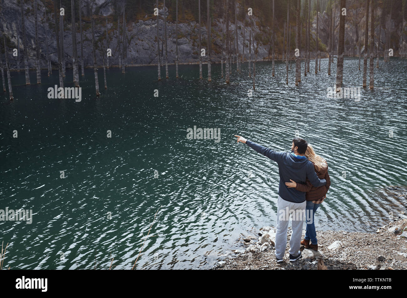 Heterosexual couple at Kaindy mountain lake, Kazakhstan - Stock Image