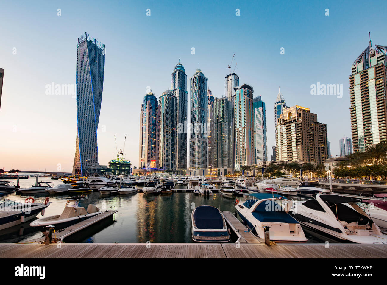Modern buildings and harbor against clear sky - Stock Image
