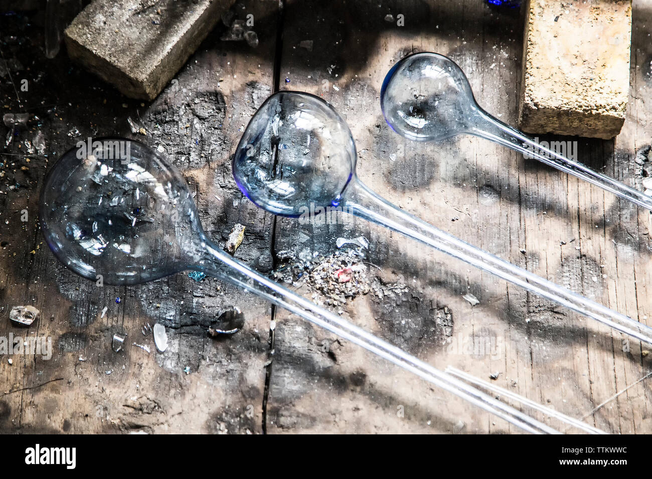 Overhead view of manufactured glasses on work bench at factory Stock Photo