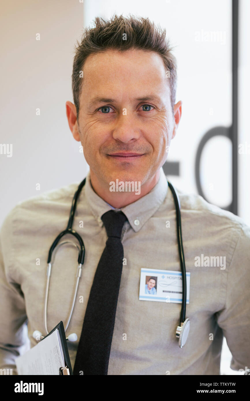 Portrait of smiling doctor at hospital - Stock Image
