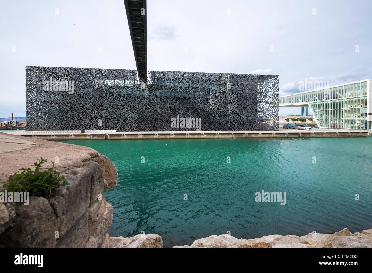 Museum of European and Mediterranean Civilisations and Villa Mediterranean against sky - Stock Image