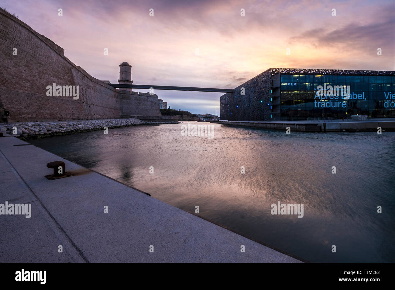 Museum of European and Mediterranean Civilisations with Fort Saint jean against sky during sunset - Stock Image