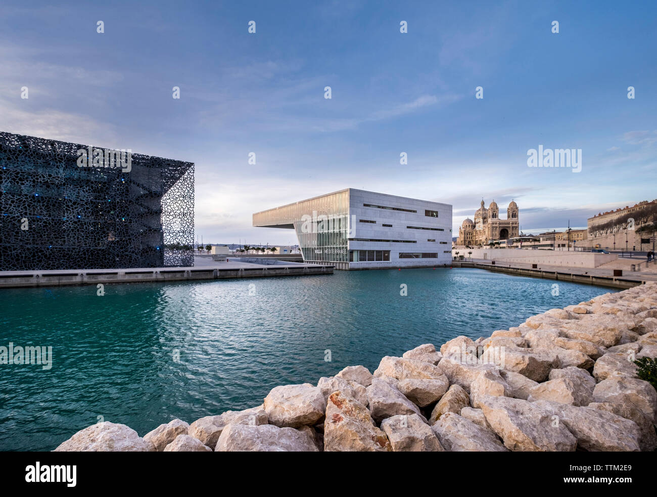 Villa Mediterranean with Museum of European and Mediterranean Civilisations and Marseille Cathedral in city against sky - Stock Image