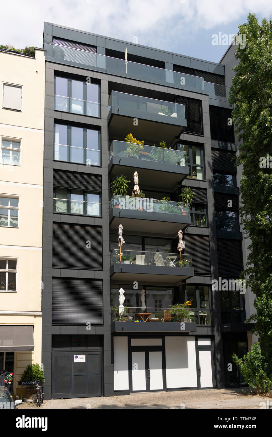 Exterior of luxury modern apartment building in gentrified ...