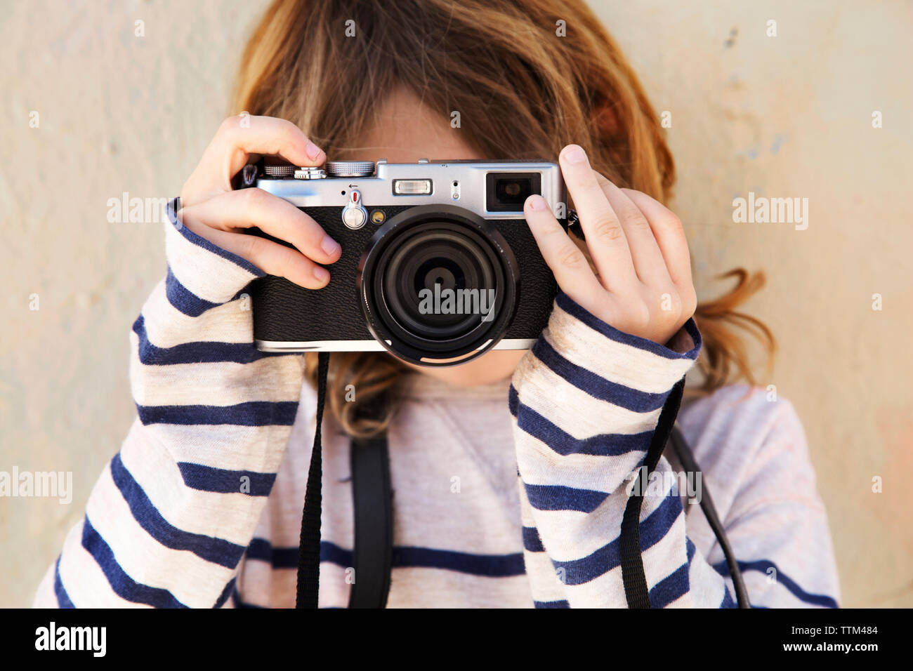 Close-up of boy photographing with camera - Stock Image