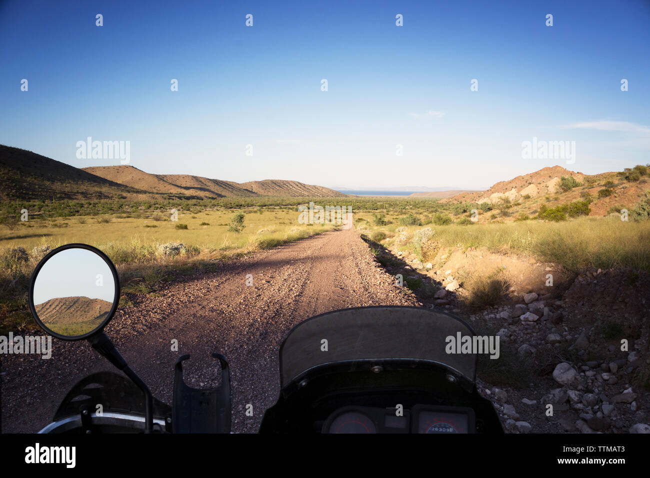 View of field from motorcycle - Stock Image