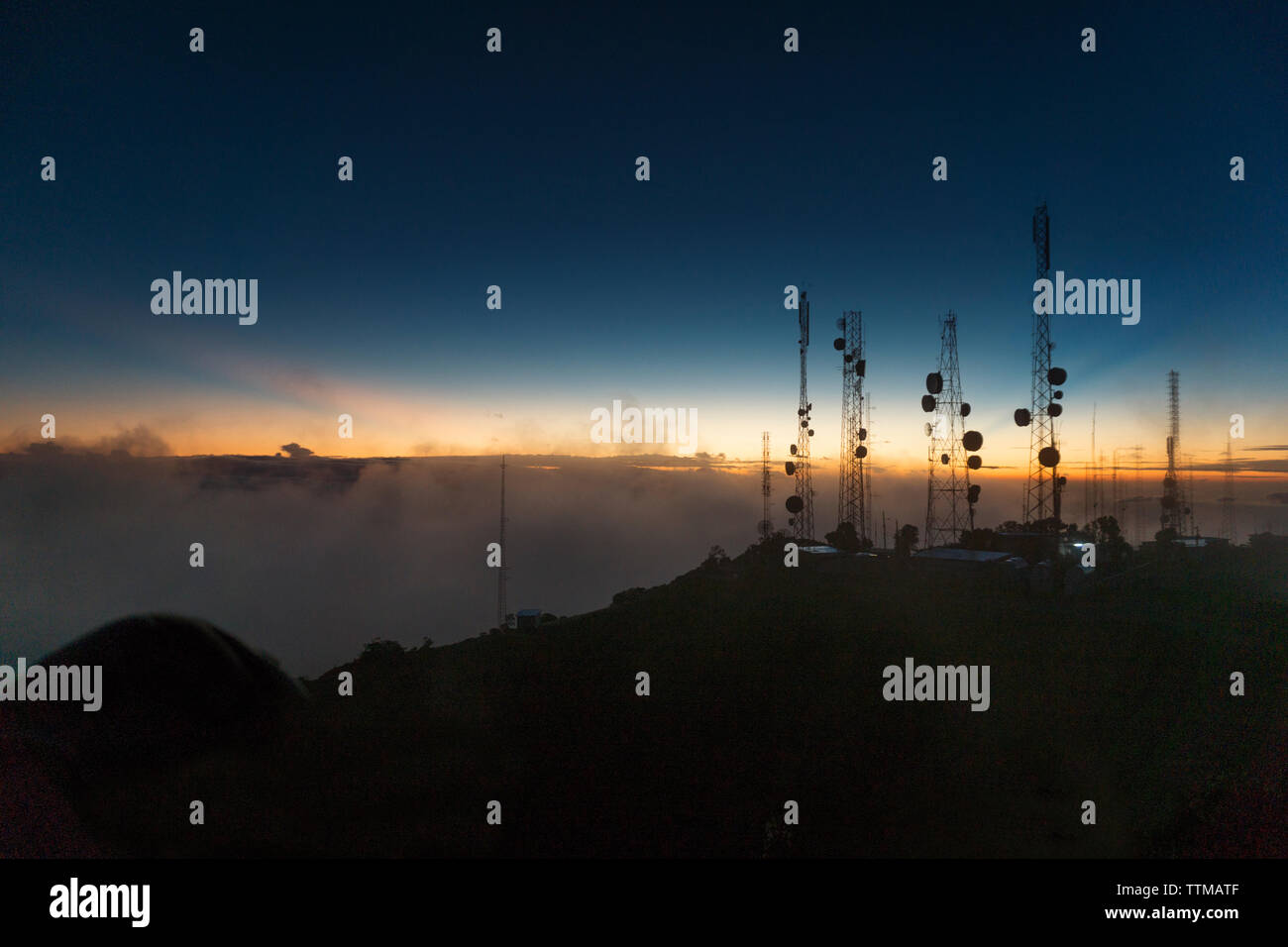 Silhouette of Telcom towers at Volcan Baru during sunset Stock Photo