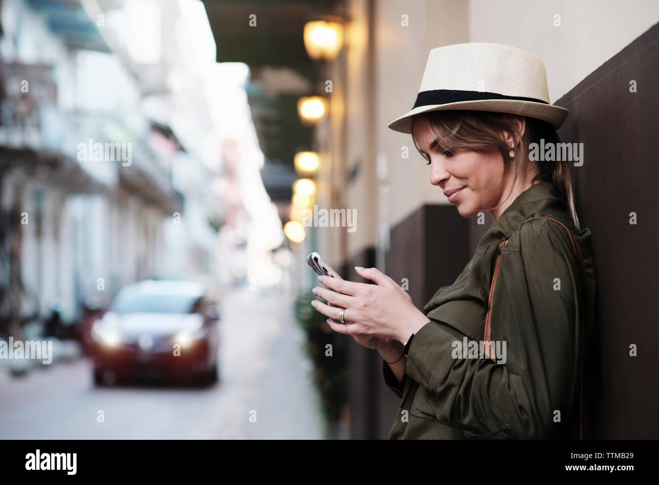 Young Woman Vacationing in Panama waits for Uber car in Casco Antiguo Stock Photo