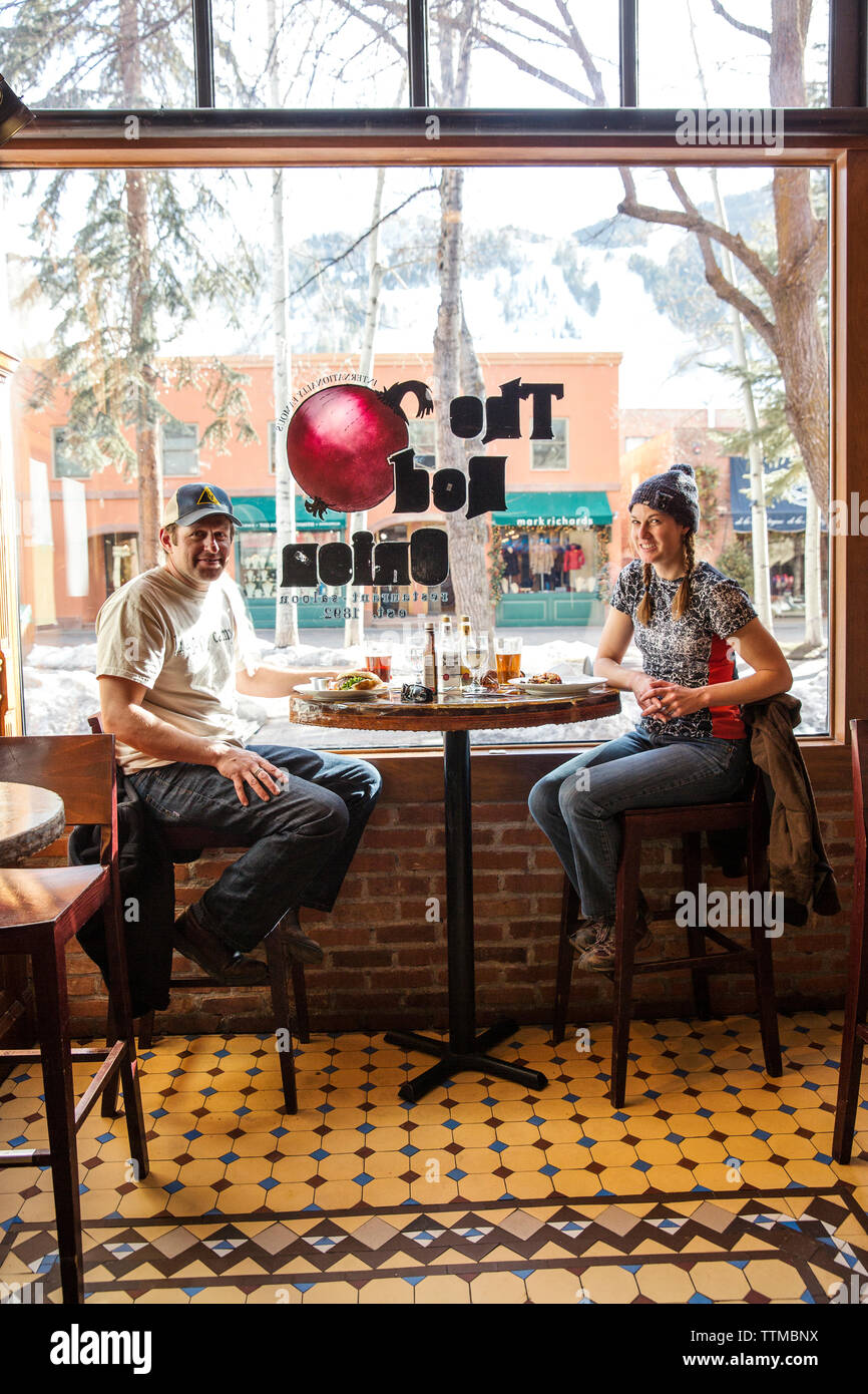 USA, Colorado, Aspen, a couple has lunch at The Red Onion restaurant in downtown - Stock Image