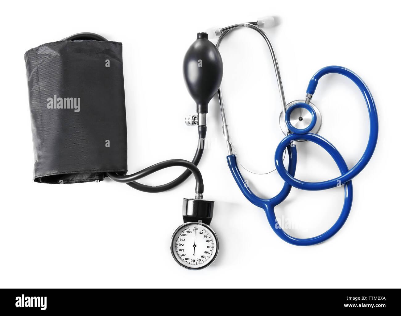 Stethoscope and tonometer, isolated on white - Stock Image
