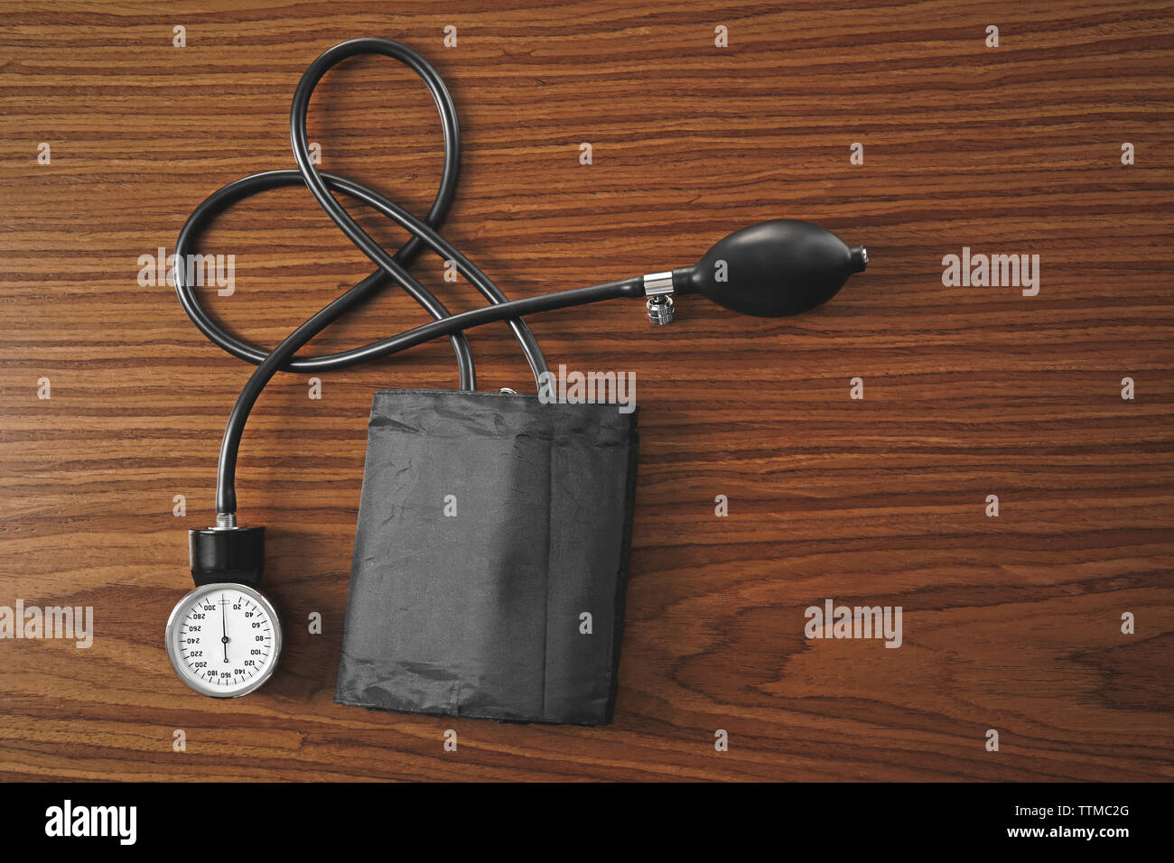 Tonometer on wooden table - Stock Image