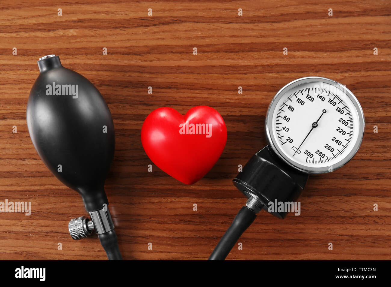 Tonometer with red heart, closeup - Stock Image