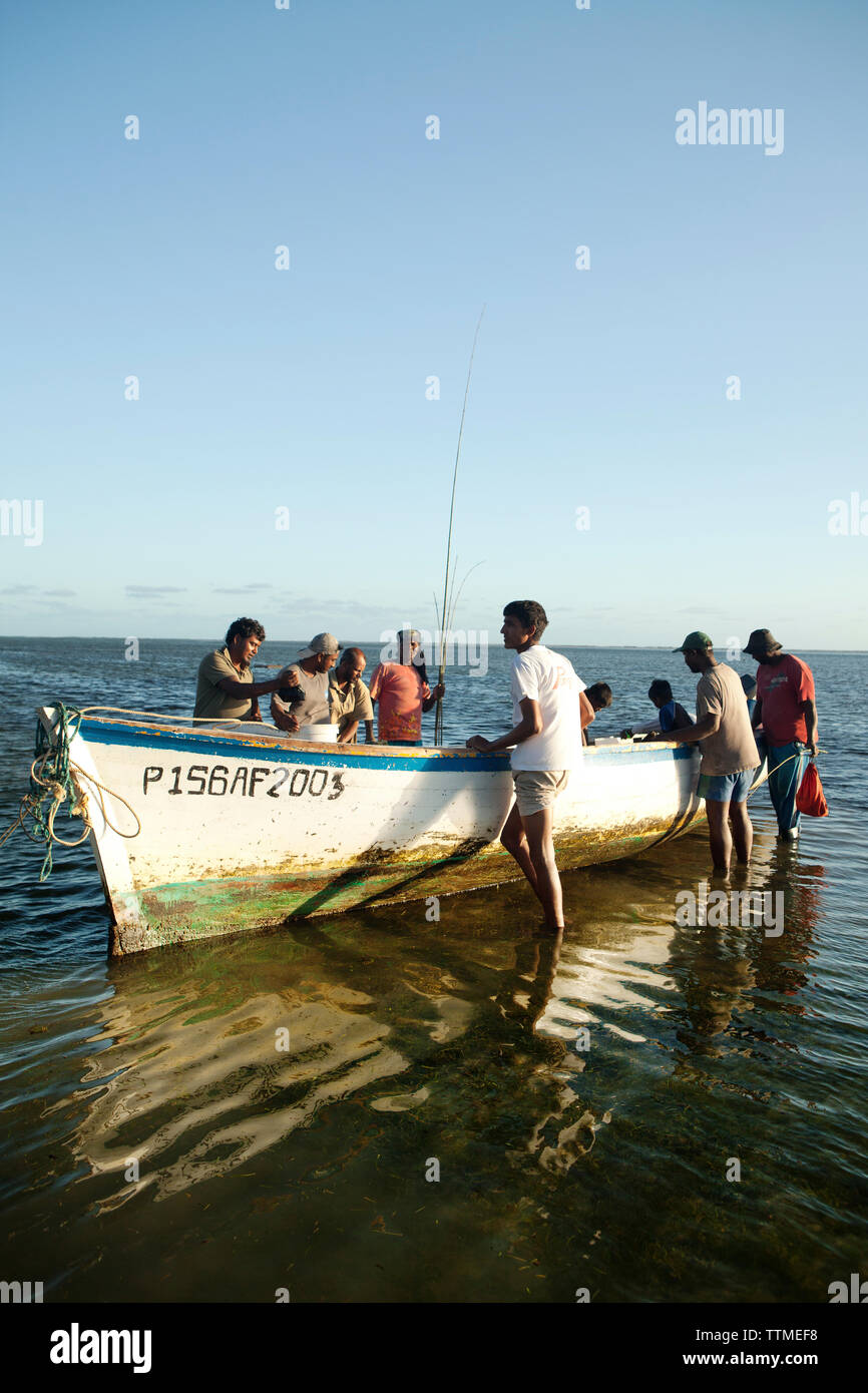 MAURITIUS, fishermen pull their rods and catch out of a boat after a day of fishing, Bel Ombre, Indian Ocean - Stock Image