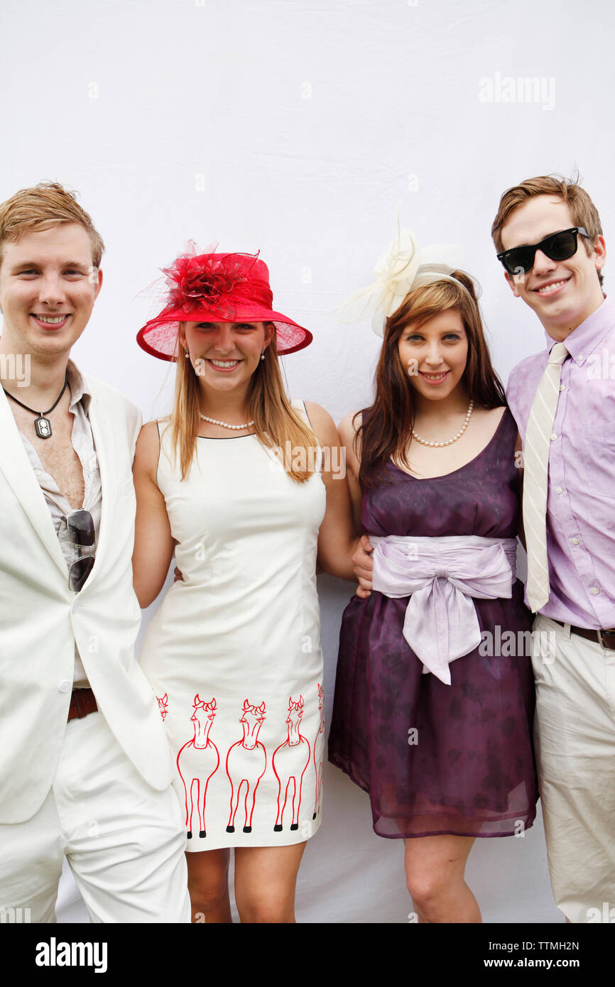 USA, Tennessee, Nashville, Iroquois Steeplechase, spectators pose for a portrait on race day near the society tent - Stock Image
