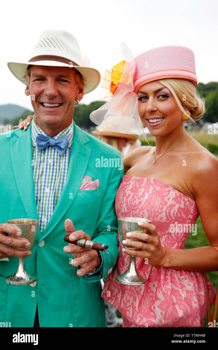 USA, Tennessee, Nashville, Iroquois Steeplechase, spectators linger on the track between races - Stock Image