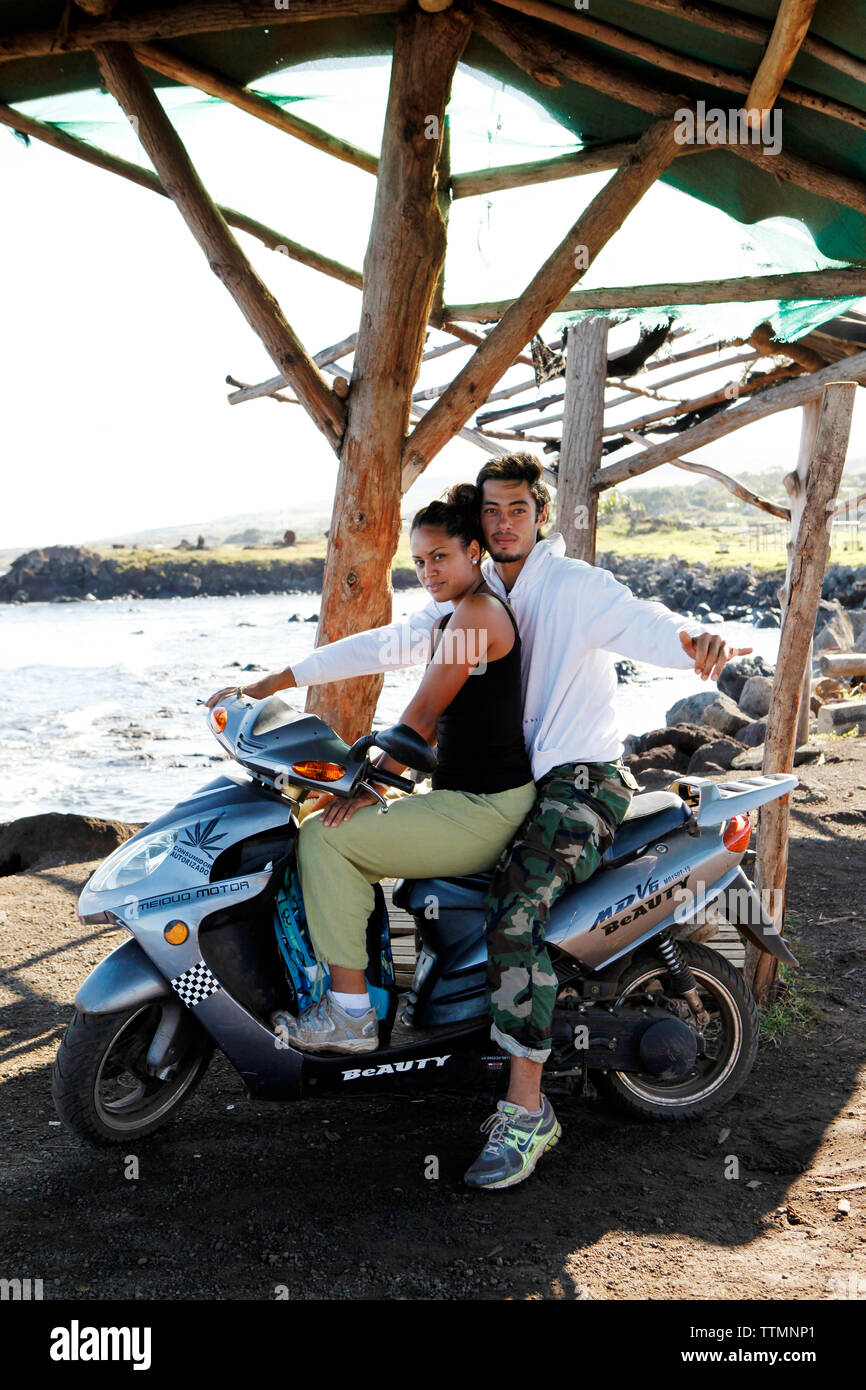 EASTER ISLAND, CHILE, Isla de Pascua, Rapa Nui, a couple poses on their motorcycle near Hanga Roa - Stock Image