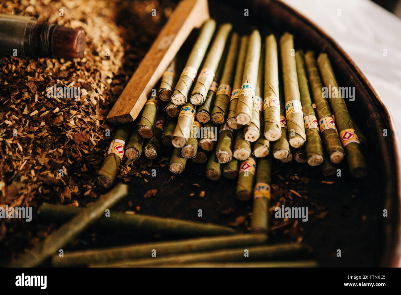 High angle view of cigars in container - Stock Image