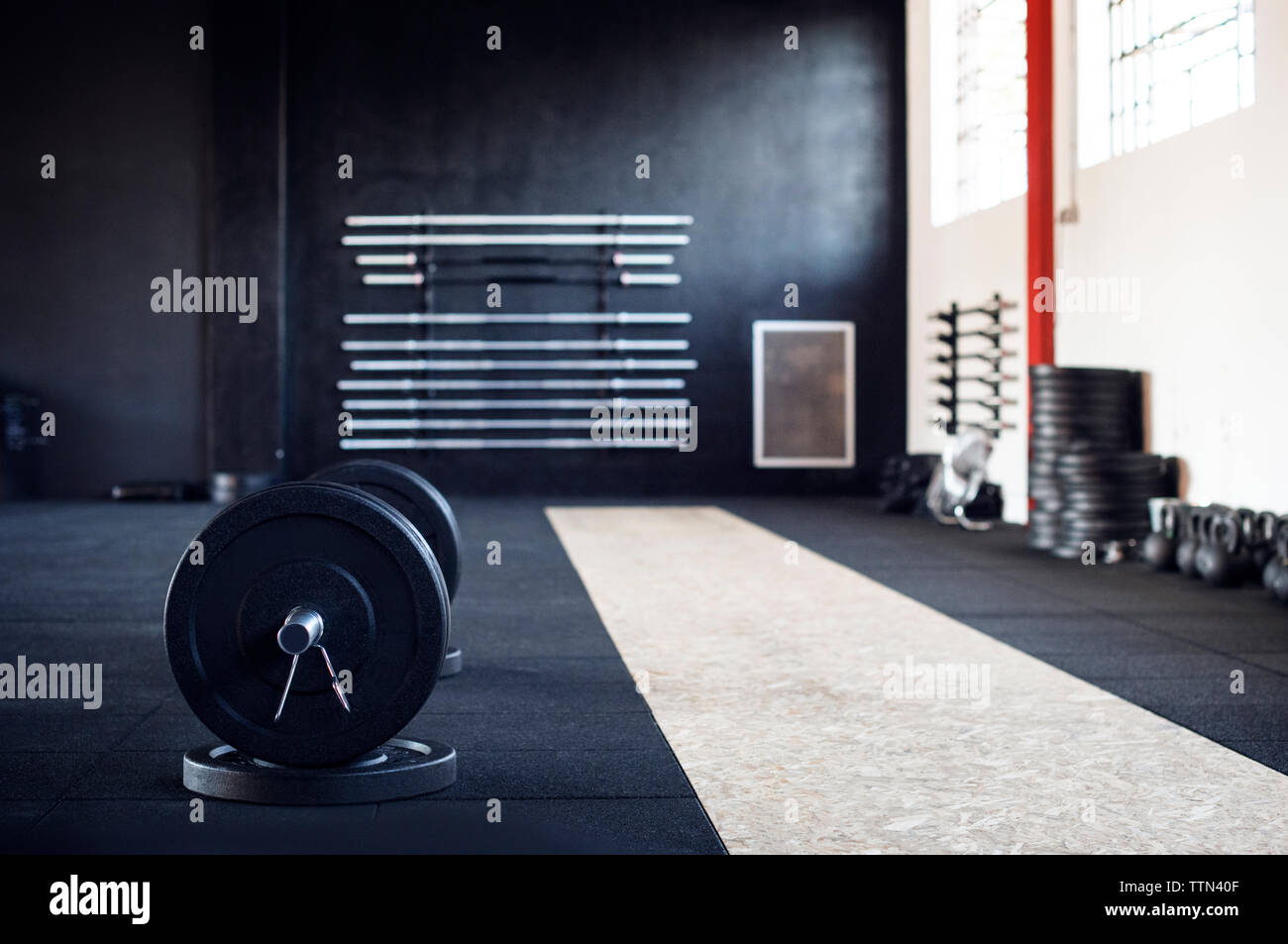 Barbell in gym - Stock Image