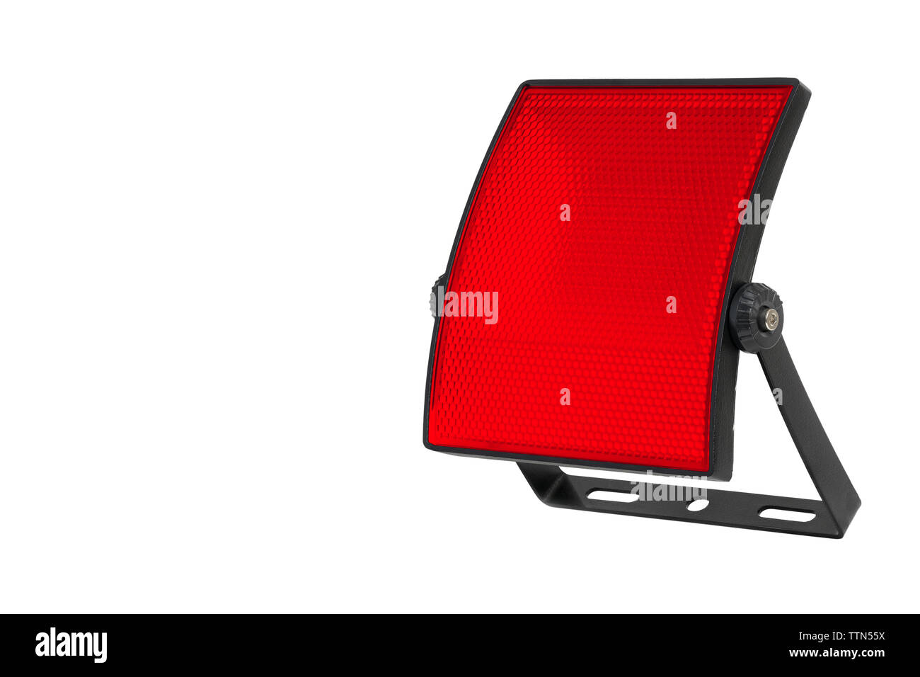 Curved LED spotlight and mounting bracket on a white background. Red diffuser with small cells. A high resolution. - Stock Image