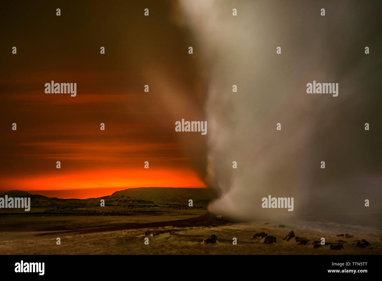 Fumaroles emitting steam during sunrise - Stock Image