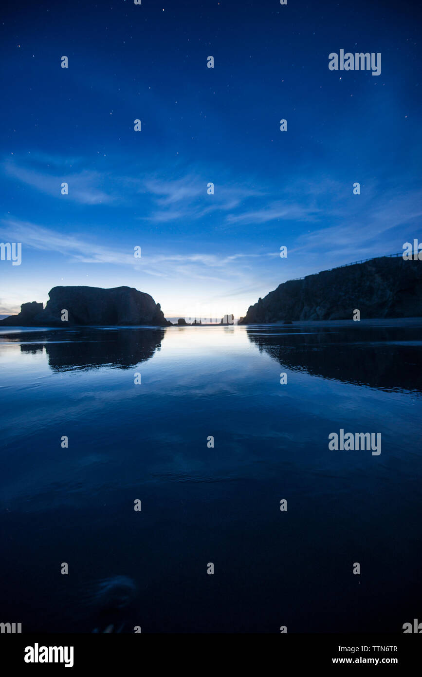 Symmetric view of Bandon Beach during sunrise - Stock Image