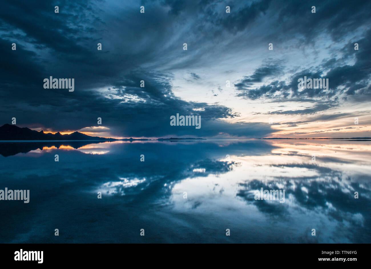 Symmetry view of Bonneville Salt Flats against cloudy sky Stock Photo