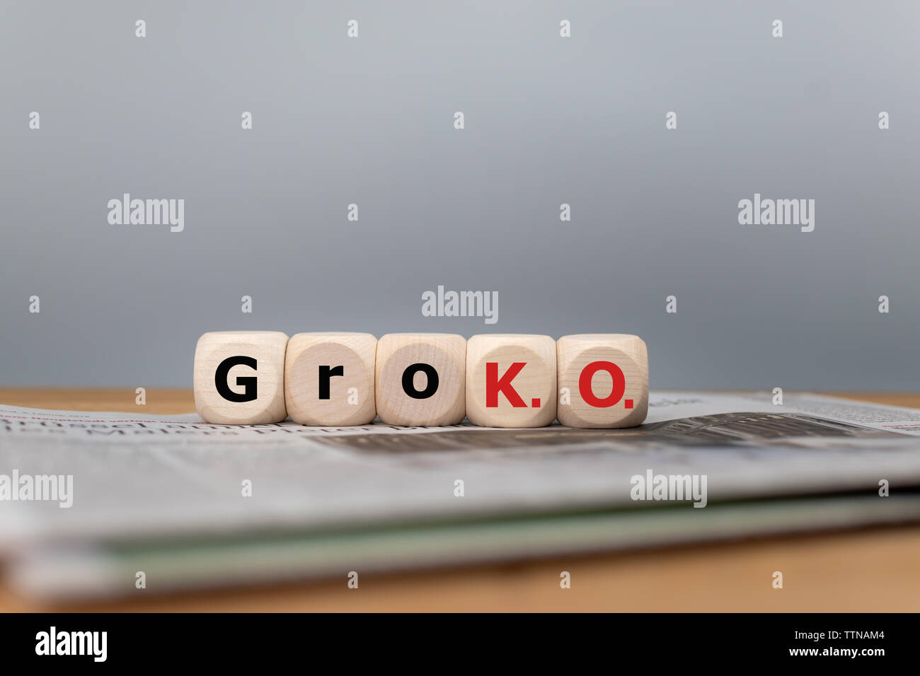 Symbol for the end of the grand coalition called 'GroKO' between the parties SPD and CDU in Germany. Cubes form the abbreviation 'GroKO' placed on a n - Stock Image
