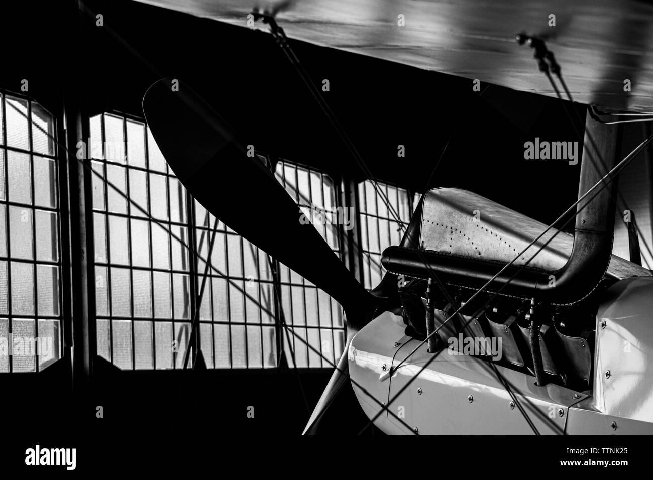 Albatros D.Va replica German Historic bi-plane silhouette / rim-lit inside a hangar - Stock Image