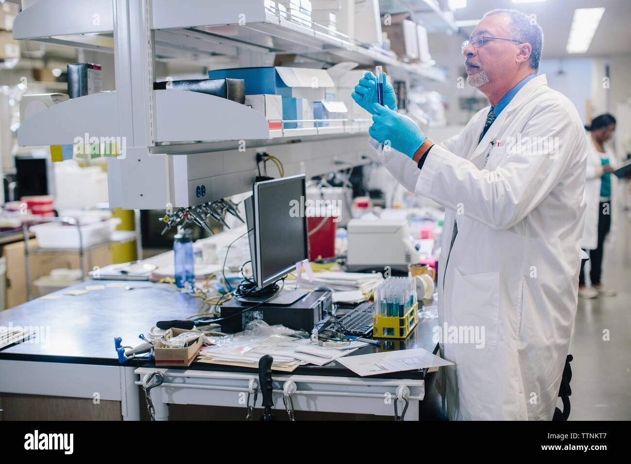 Male doctor examining test tubes in laboratory Stock Photo