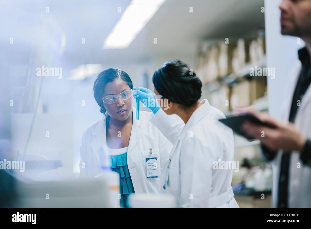 Female doctors examining test tubes in laboratory Stock Photo
