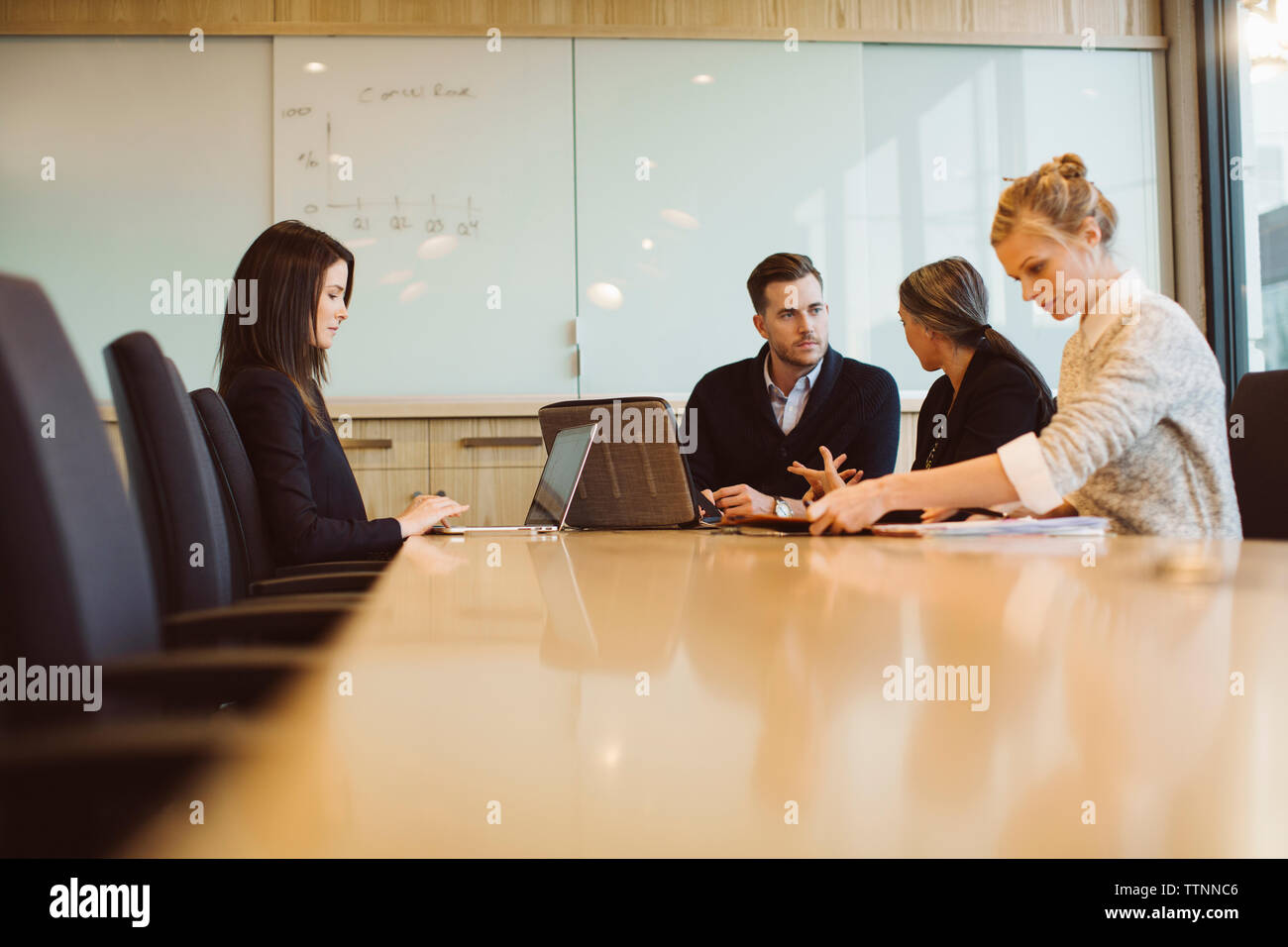 Business people discussing in meeting at board room - Stock Image