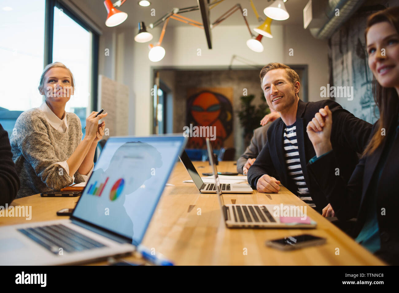 Business people in meeting at board room - Stock Image